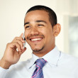 Laughing man on mobile phone — Stock Photo