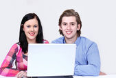 Happy couple purchasing a service online — Stock Photo