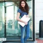 Girl leaving office — Stock Photo