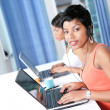 Stock Photo: Two women trading online