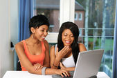 Girls fun on computer — Stock Photo