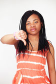 Thumbs down - ethnic girl — Stock Photo
