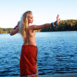 Woman lake yoga — Stock Photo