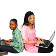 Cute kids on laptops — Stock Photo