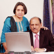 Senior indian couple at computer — Stock Photo