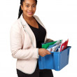 Smiling woman with box of files — Stock Photo
