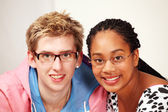 Cute mixed couple with spectacles — Stock Photo