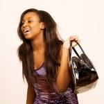 Laughing girl with handbag — Stock Photo