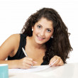 Smiling girl filling application — Stock Photo