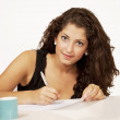 Stock Photo: Young woman filling document