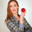 Pretty girl holding apple — Stock Photo