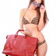 Beach trip girl in bikini with red bag — Stock Photo