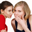 Women sharing secret — Stock Photo