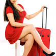 Traveling woman with suitcase — Stock Photo