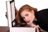 Pretty secretary at photocopier — Stock Photo