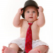 Baby boy sitting with hat and tie — Stock Photo