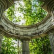 Columns in park, dramatical — Stock Photo
