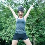 Happy beautiful girl jump on park — Stock Photo