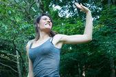 Happy beautiful girl run and say hello on park — Stock Photo