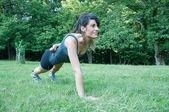 Female athlete training on camaldoli park — Stock Photo