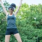 Beautiful athlete girl jump on Camaldoli park — Stock Photo #51432109