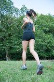 Female athlete running  on camaldoli park — Stock Photo