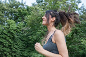 Female athlete running on park — Stock Photo