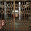 Asian rustiness chinese traditional gate or folding doors in the shop with the vintage style - architectural structure in Yau Ma Tei Wholesale Fruit Market — Stock Photo