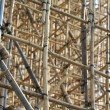 Thousands of bamboo which is the Scaffolding project in office building construction site in hong kong downtown — Stock Photo #46875599