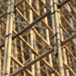 Thousands of bamboo which is the Scaffolding project in office building construction site in hong kong downtown — Stock Photo #46875719