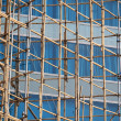Traditional bamboo Scaffolding big project in front of modern office glass building in hong kong, Asian housing tech — Stock Photo #46875805