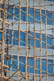 Traditional bamboo Scaffolding big project in front of modern office glass building in hong kong, Asian housing tech — Stock Photo