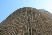 Thousands of bamboo which is the Scaffolding project in office building construction site in hong kong downtown — Stock Photo