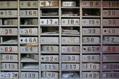 Old vintage metal made, ruined traditional chinese empty or full mailboxes — Stock Photo