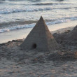 Sand pyramid on the beach — Stock Photo