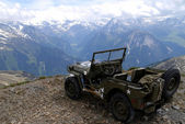 Military jeep in the mountain — Stock Photo