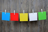 5 colored post it hanging — Stock Photo