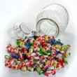 Glass jar with candies — Stock Photo