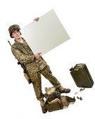 Young American soldier shows a sign — Stock Photo