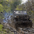 Stock Photo: World war two military vehicle run in mud