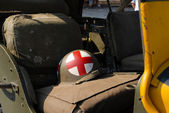 World war two helmet placed on the military truck — Stock Photo