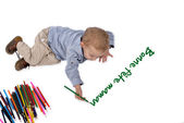 Baby draws with crayons bonne fetes maman — Stockfoto