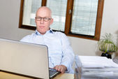 Senior man at the office — Stock Photo