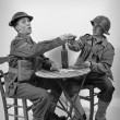 An English soldier and an American soldier drink a glass of wine — Stock Photo