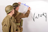 An English soldier and an American soldier write on the wall — Stock Photo