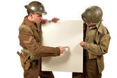 Bristish and american soldier show a poster — Foto de Stock