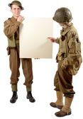 Bristish and american soldier present a plate — Stock Photo