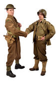 An English soldier and an American soldier shake hands — Stock Photo
