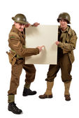 Bristish and american soldier show a poster — Stock Photo