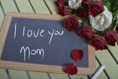 Writing I love you mother on the slate — Stock Photo